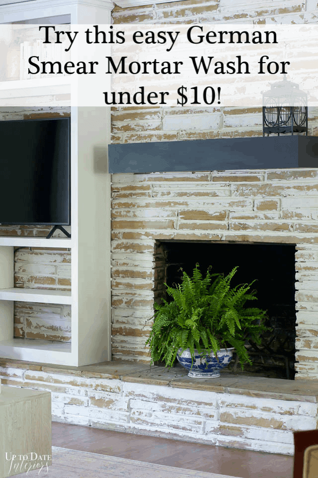 German Smear Stone Fireplace with tan stone and a white mortar wash.  White built in and fern on fireplace.