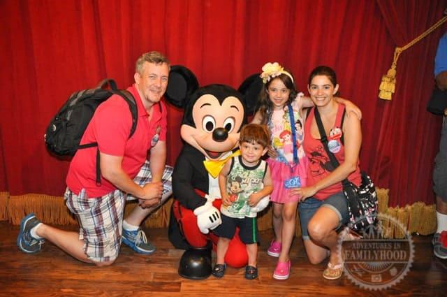 James carries Disney Park essentials in his backpack