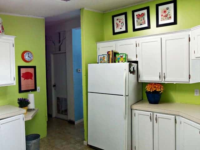 kitchen with green walls and white cabinets