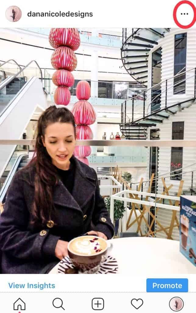 Girl sitting in a mall with a cup of coffee