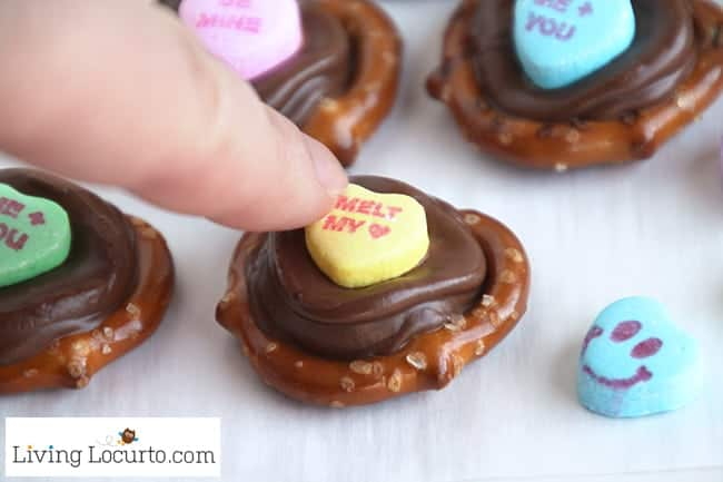 Valentine's Day Chocolate Pretzels are perfect for school parties or gifts! Kids will love picking out their favorite conversation heart candy saying. This no bake recipe makes a delicious salty, crunchy chocolate caramel dessert. ~ LivingLocurto.com