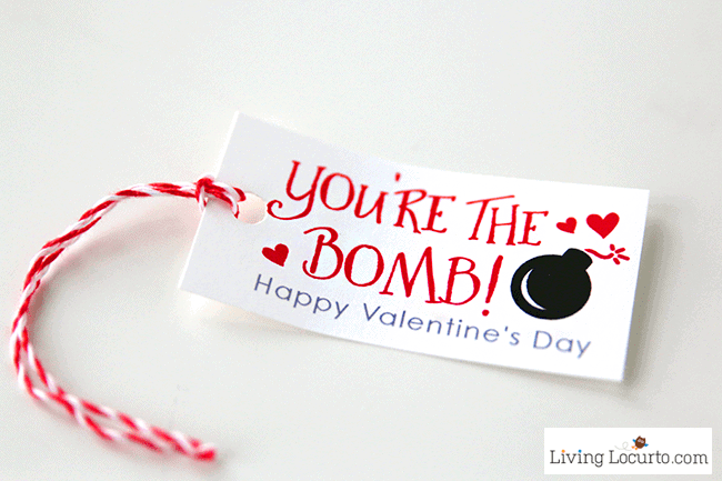 Creative DIY Valentine's Day Candy Gift! This cute Valentine candy love bomb is fun for school Valentine's Day parties or a teacher gift. A sweet candy craft gift idea that's dynamite!