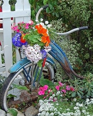 Bike Planter! Creative ways to add color and joy to a garden, porch, or yard with DIY Yard Art and Garden Ideas! Repurposed ideas for the backyard. Fun ideas for flower gardens made from logs, bikes, toys, tires and other old junk. ~ LivingLocurto.com