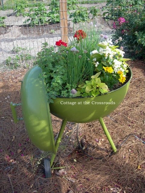 Repurposed Grill - Creative ways to add color and joy to a garden, porch, or yard with DIY Yard Art and Garden Ideas! Repurposed ideas for the backyard. Fun ideas for flower gardens made from logs, bikes, toys, tires and other old junk. ~ featured at LivingLocurto.com