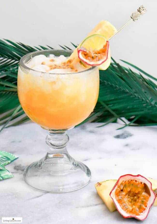 An easy Passion Fruit Tropical Rum Punch cocktail recipe. Make a pitcher of this easy tropical rum drink for your next party. Luau party ideas.