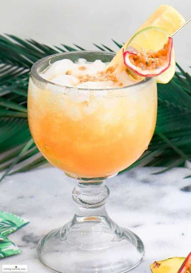 Passion Fruit Tropical Rum Punch cocktail recipe. Make a pitcher of this easy tropical rum drink for your next luau party.