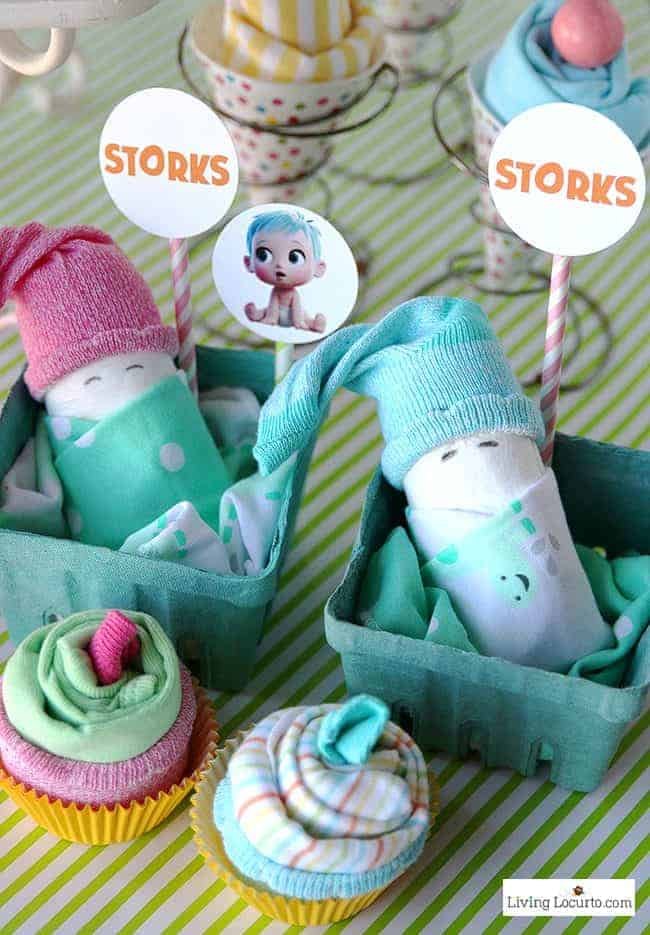 STORKS movie themed Baby Shower Party Ideas and how to make adorable Baby Pacifier Cupcakes. Free printables and diaper cake craft inspiration. LivingLocurto.com