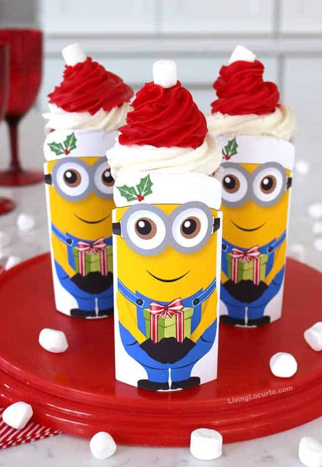 Minions Christmas cupcakes are so cute! With a free printable, soda can and Santa hat cupcake this idea makes adorable Despicable Me 3 holiday party treats!