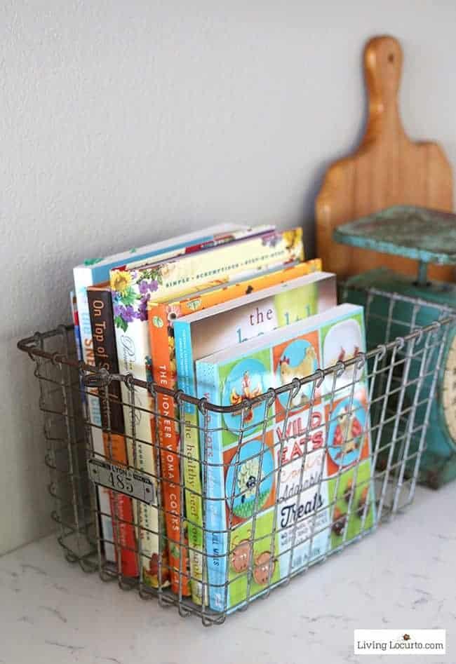 10 Simple Farmhouse Kitchen Decor Ideas - Vintage wire locker baskets to hold cookbooks.