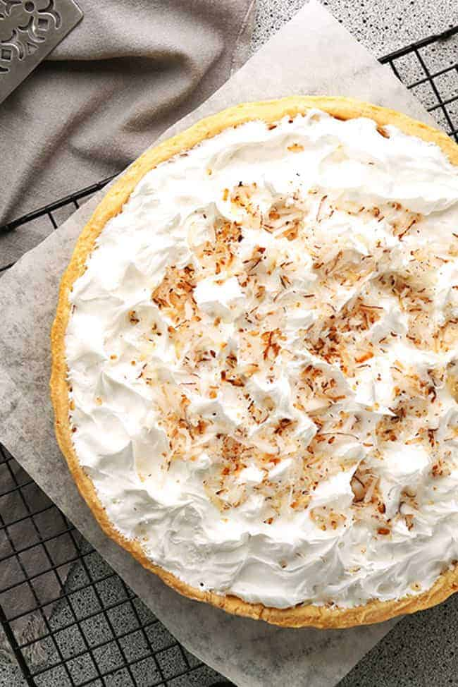 This creamy, fresh homemade Coconut Cream Pie Recipe is a mouth-watering dessert wonderful for any occasion!