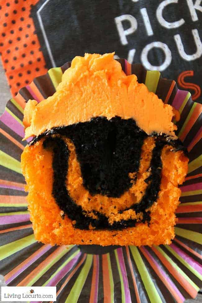 Halloween Cupcakes an Easy Tie Dye Cake Recipe. Orange and black tie dye cupcakes with black cat lollipops.
