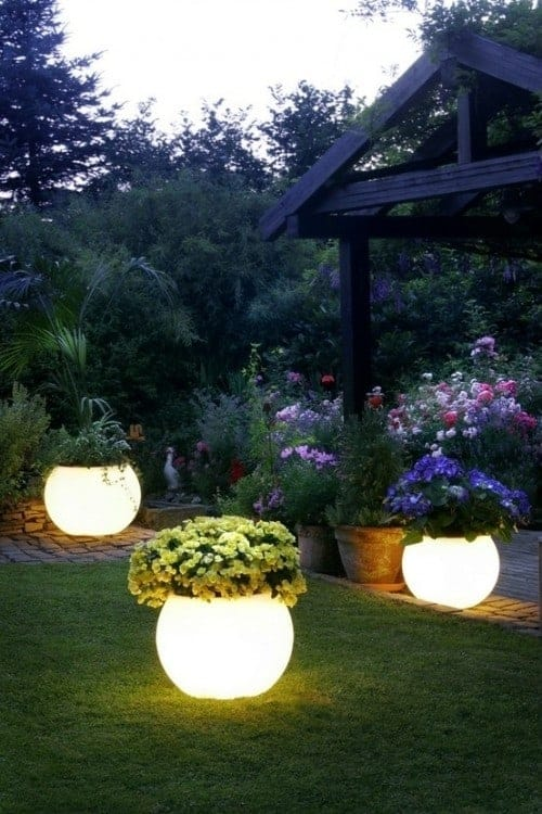 Glow in the dark flower planters! Creative ways to add color and joy to a garden, porch, or yard with DIY Yard Art and Garden Ideas! Repurposed ideas for the backyard. Fun ideas for flower gardens made from logs, bikes, toys, tires and other old junk. ~ featured at LivingLocurto.com