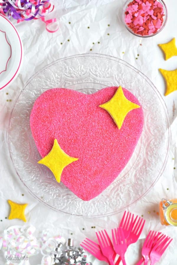 Emoji Pink Sparkly Heart Party Cake - Emoji cake ideas and dessert inspiration for an Emoji Party. From birthday and graduation parties to school events, an emoji party theme is fun for all! LivingLocurto.com