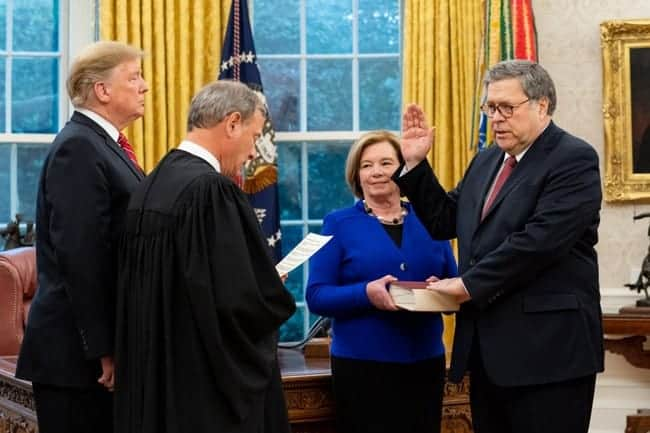 William Barr holding the bible as he is being sworn in as Attorney General