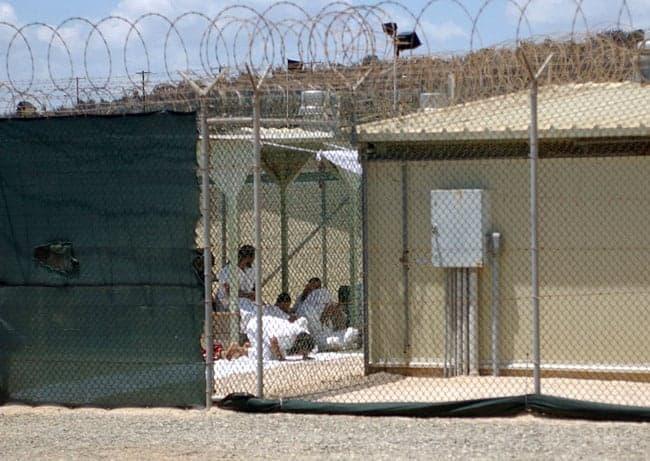 View of detainees behind fencing at Guantanamo Bay