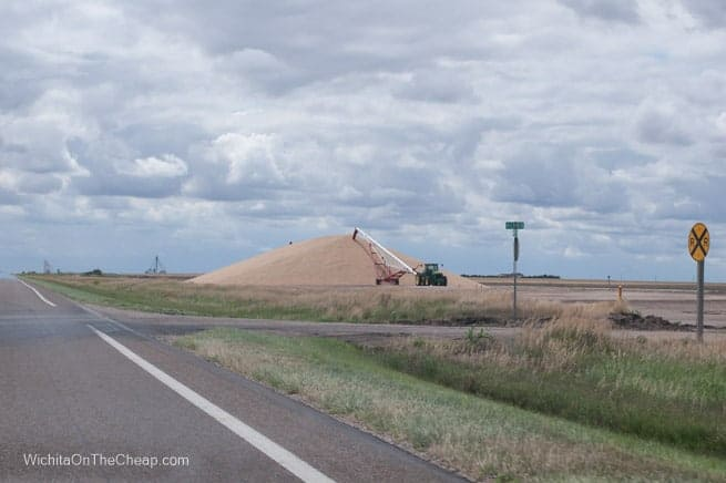 Bumper crop of wheat in western Kansas piled up on the side of a country road