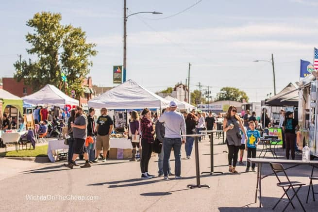 Tents, food trucks, and shoppers at The Workroom's Outdoor Market