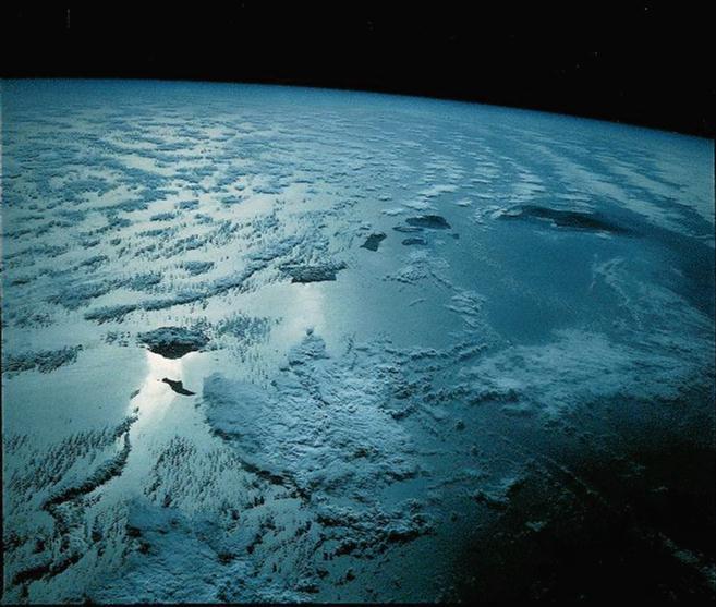 Hawaii from space at night. Bottom left to right: Nihau, Kauai, Oahu, Molokai, Lanai, Maui, Kohoolawe, and Hawaii (Big Island).