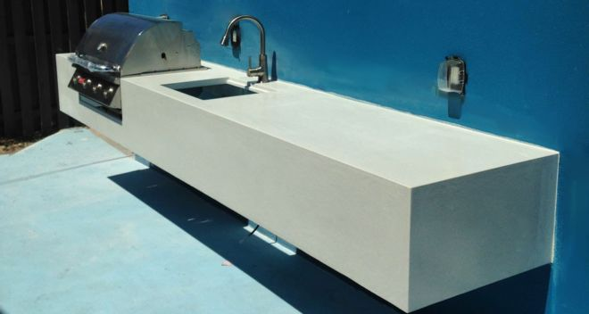 Floating Outdoor White Concrete Countertop with Inset BBQ Grill and Sink