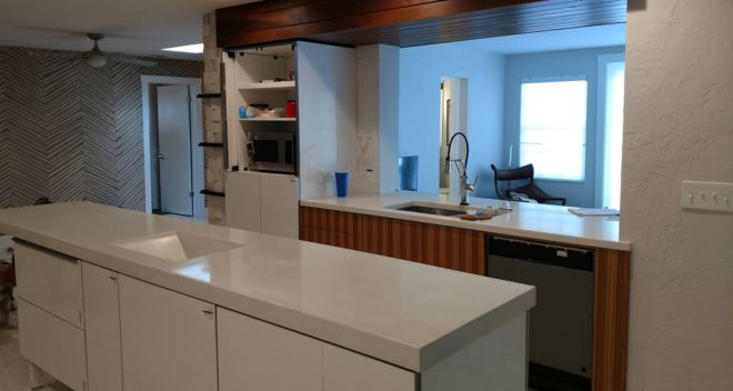 Mid Century Style with White Concrete Countertops and Walnut Cabinetry and Accents