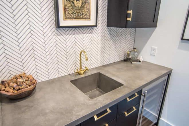 hand troweled concrete wet bar with integral sink by beton studio