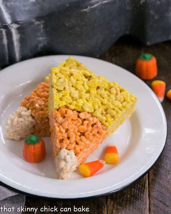 Candy Corn Rice Krispie Treats on round white plate