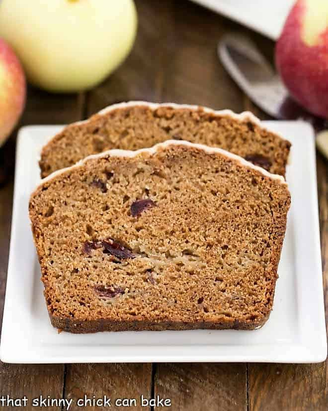 Sliced Glazed Cranberry Apple Bread slices on a square white plate