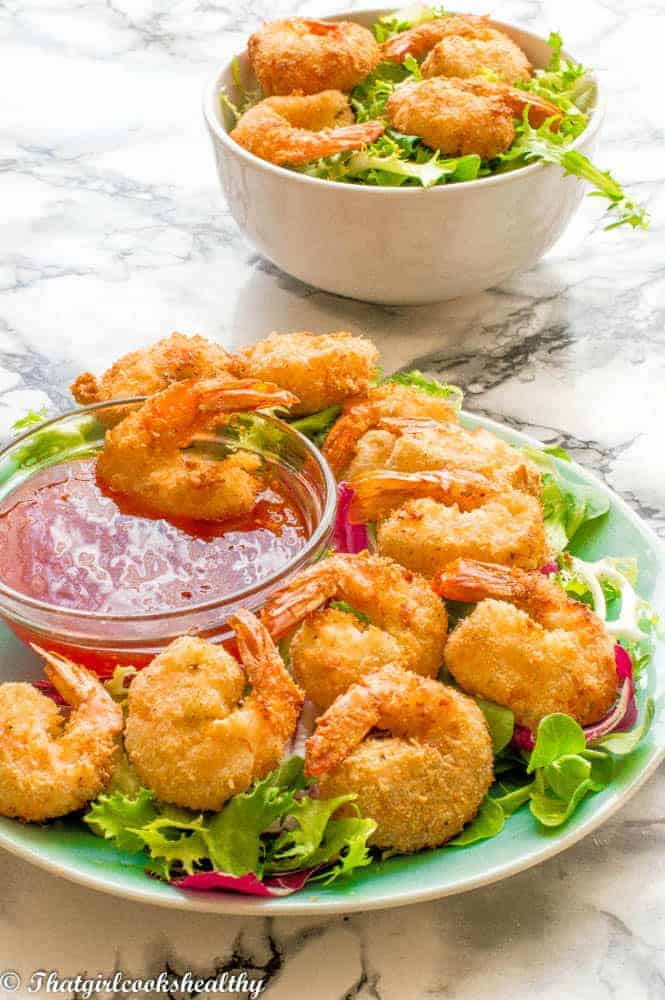 A plate of crispy cocont low carb air fryer shrimp