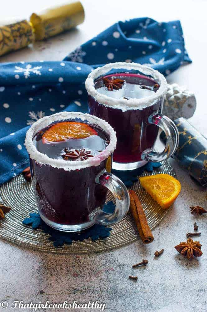 2 cups of mulled wine with accessories