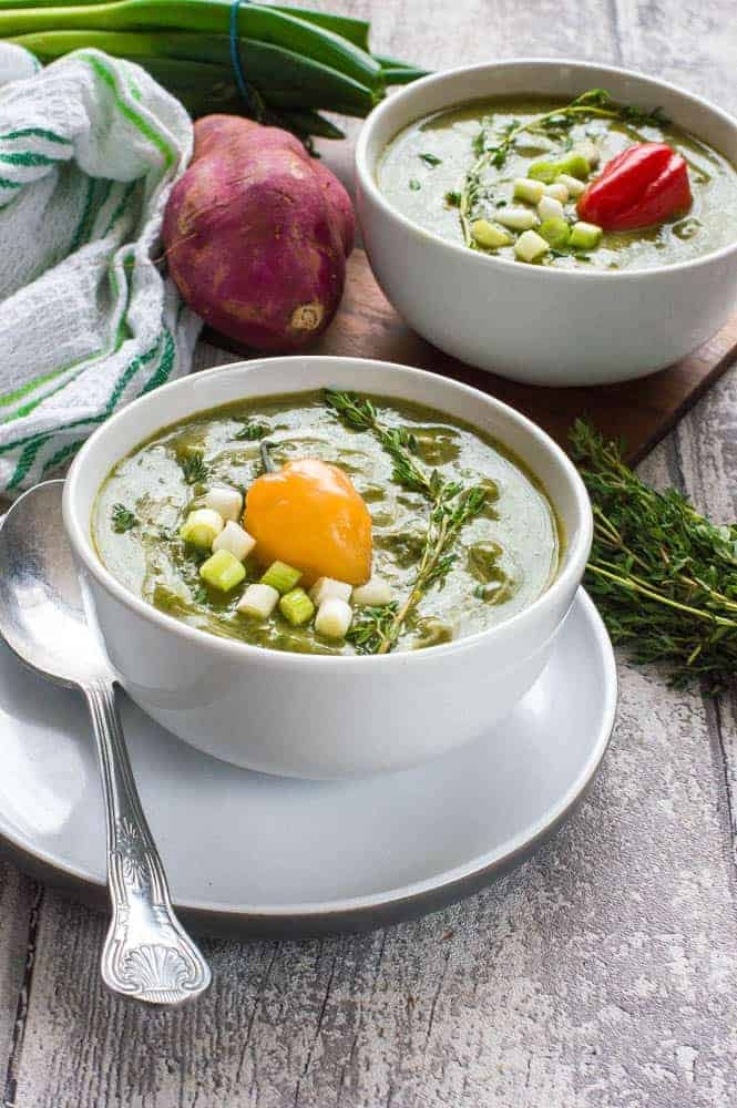 Green soup with yellow pepper on top