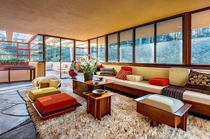 Living room of Frank Lloyd Wright's Fallingwater, a total work of art embracing its surrounding nature.