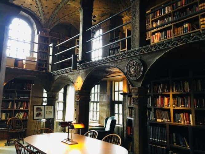 The ornate library room with art depicting local history at the mercer museum near new hope, pa