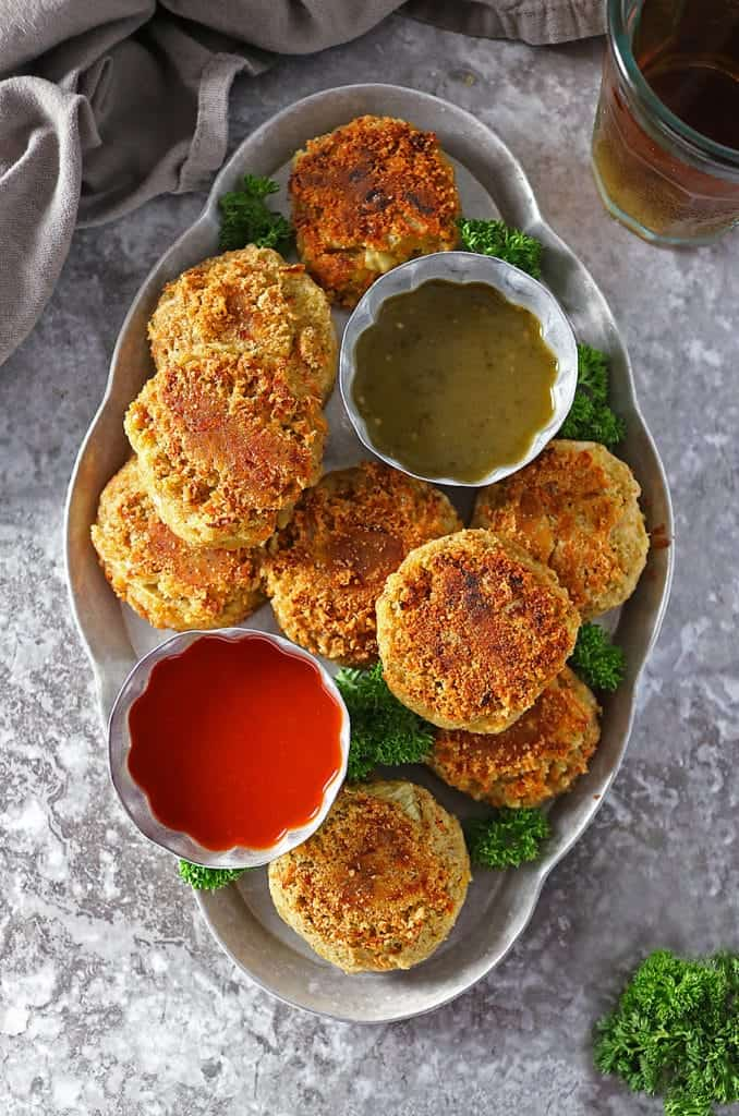 Overhead photo of Curry Spiced Lentil Burgers with 2 dipping sauces.