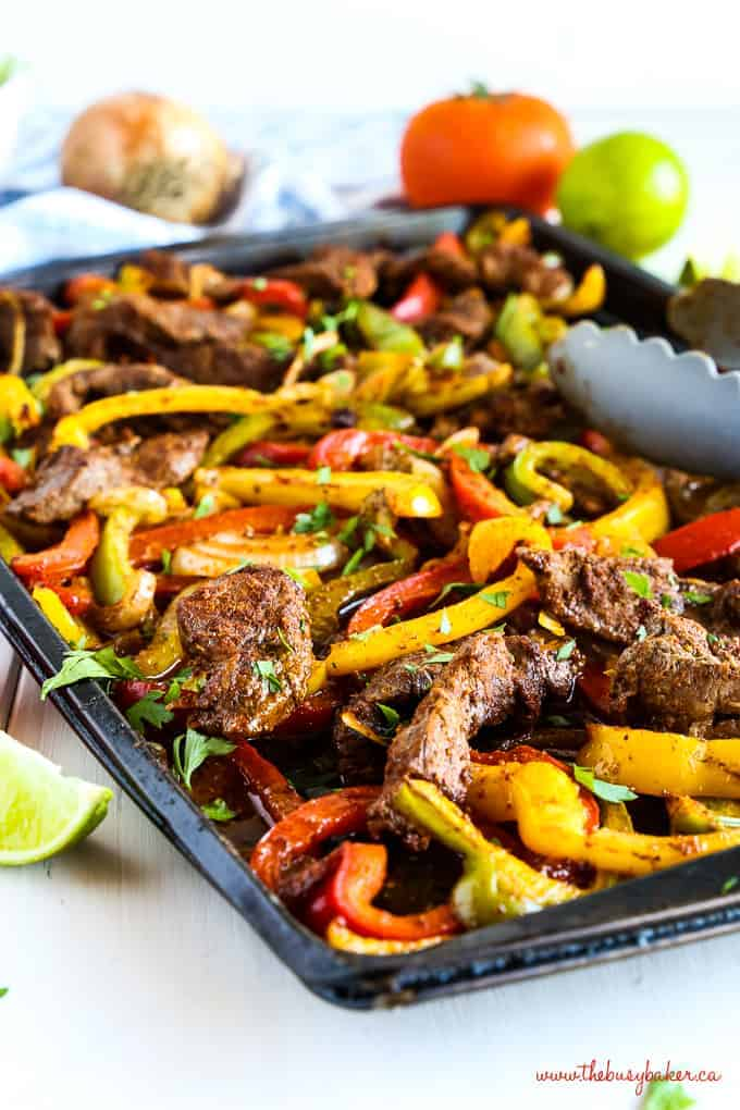 sheet pan steak fajitas with red and yellow peppers