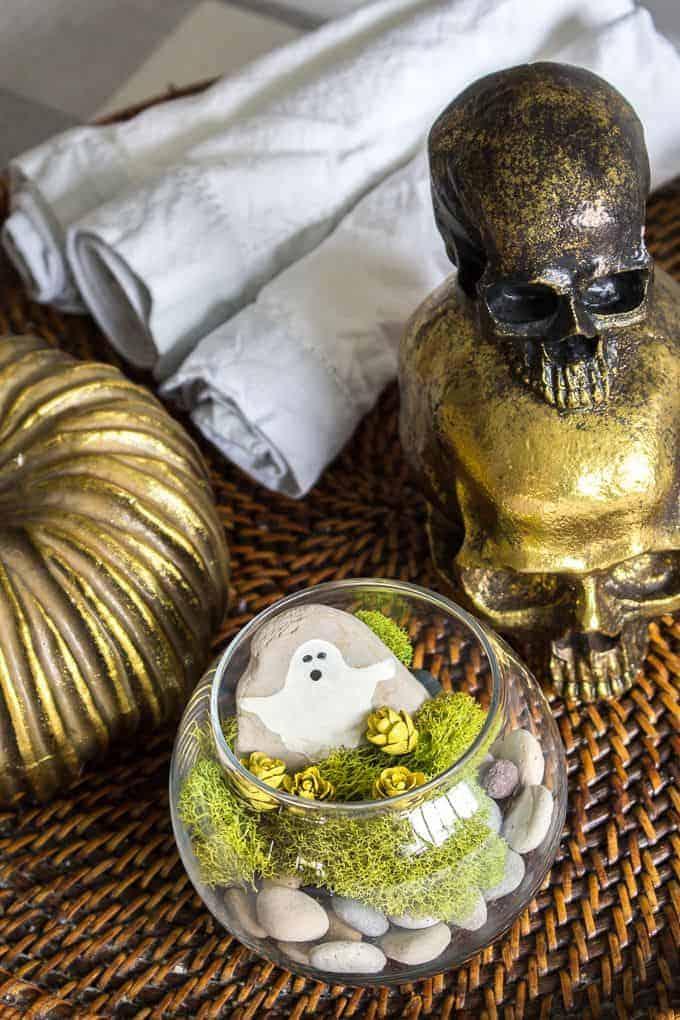 Halloween terrarium on display with gold skull decor