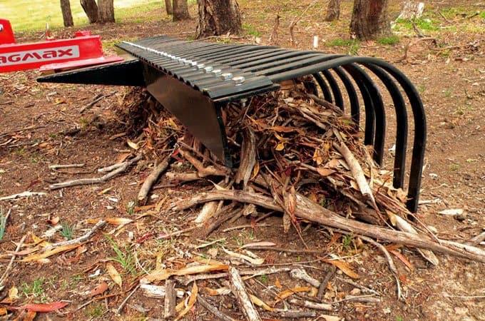 A Stick Rake can help remove bigger branches before slashing.