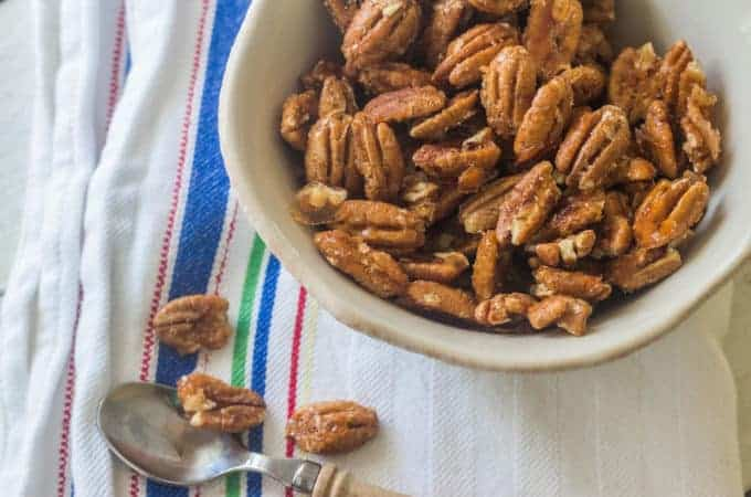 Spiced Pecans. Coat pecans with a spicy syrup and roast in the oven.