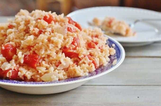 Tomatoes and Rice. Onions cooked in bacon grease and combined with tomatoes and rice.