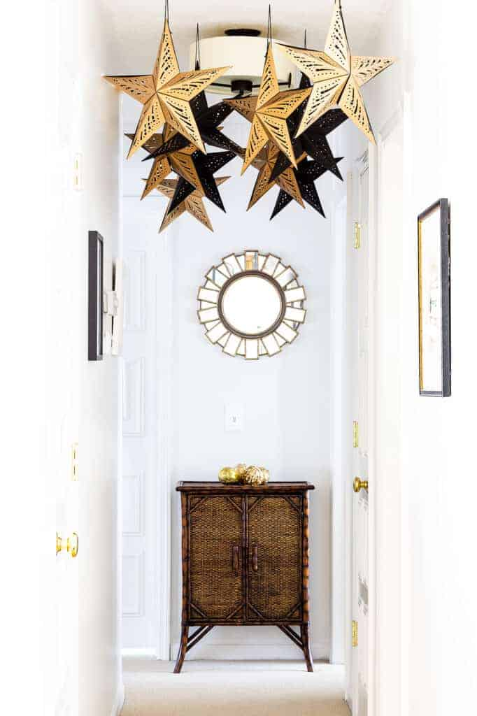 Paper stars hanging from ceiling. Neotraditional Christmas decorations for bedroom.