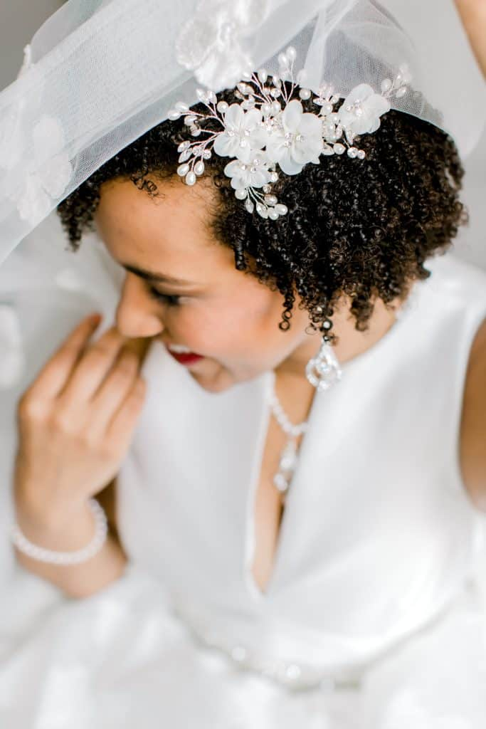 bride covered by the veil, hair updo
