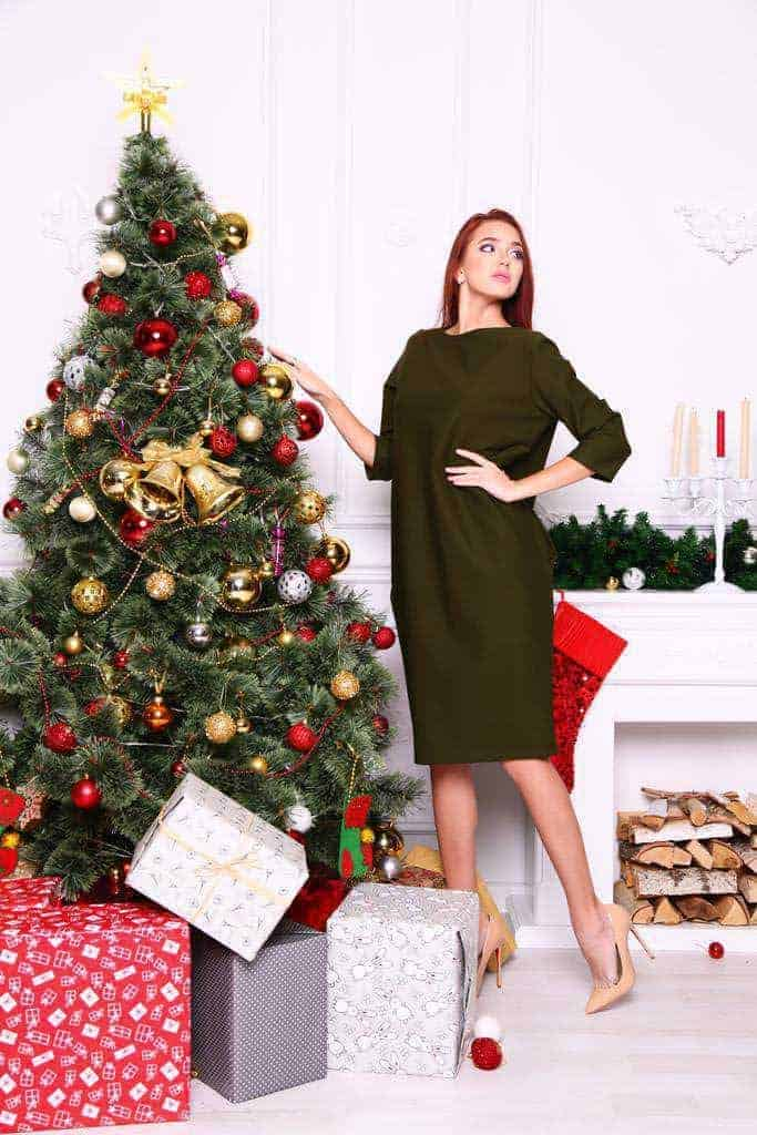 Model Near Christmas Tree
