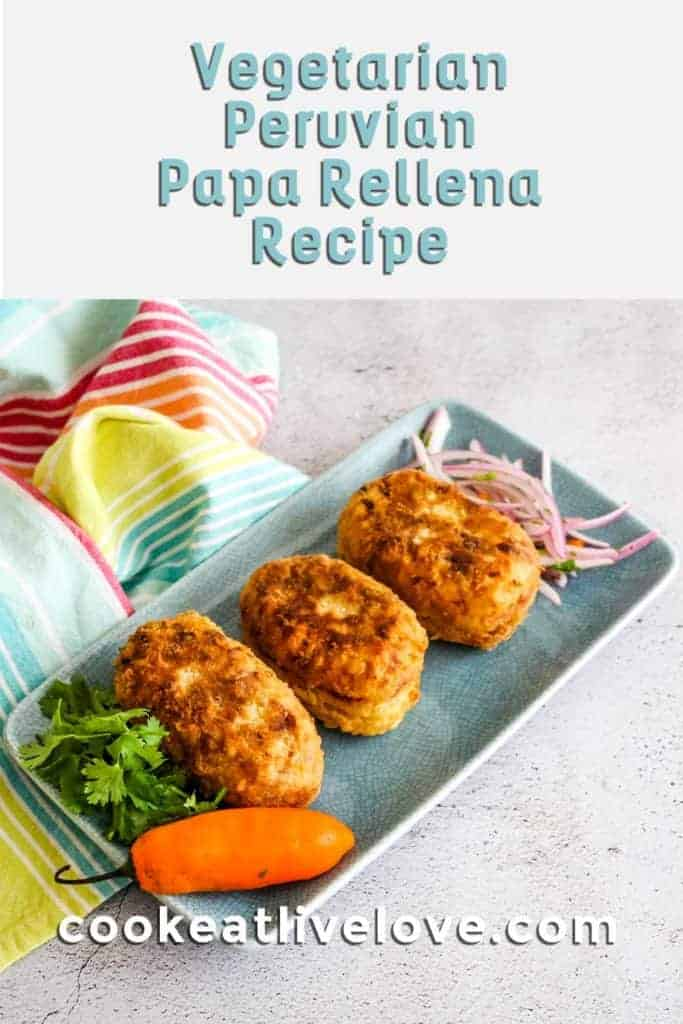 Pin for pinterest of the papa rellena with a photo of them on a blue plate and text on top.