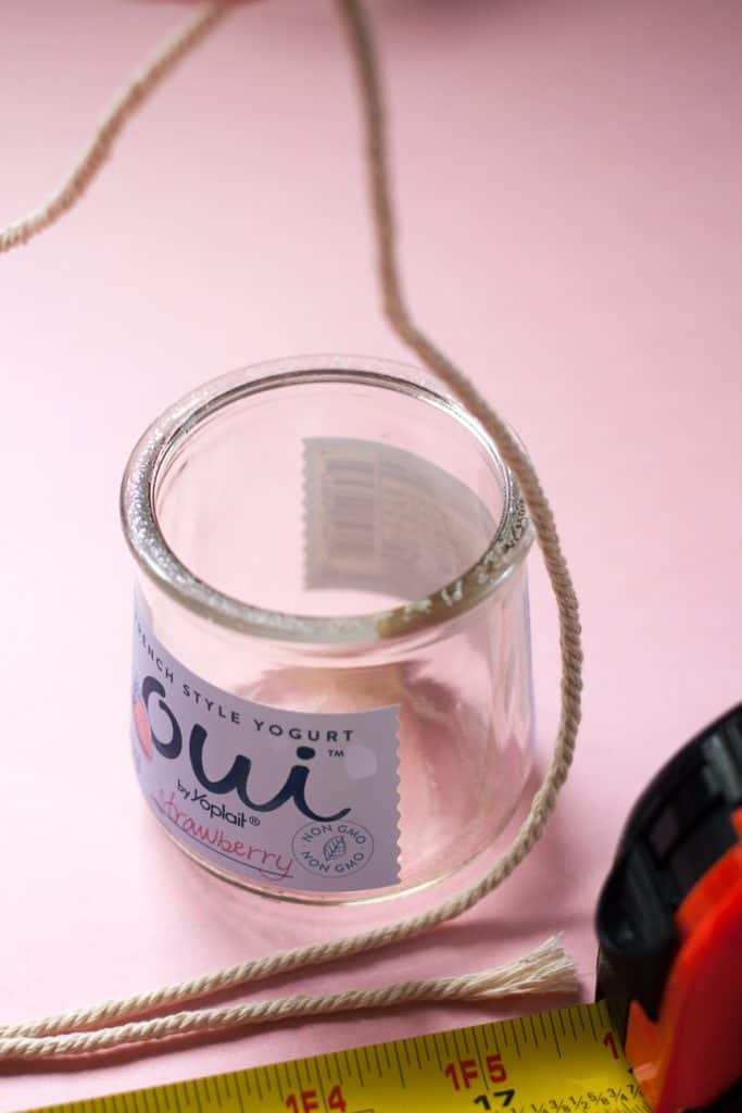 This is a diy macrame jar hanger tutorial. Macrame is still popular as ever! Today I'm going to show you how to make these DIY Macrame Jar Hangers in literally 5 minutes! And - I used leftover yogurt jars! These look so pretty - I'm obsessing over them. It will cost you a few jars or yogurt and some macrame cord. Easy, inexpensive and beautiful!