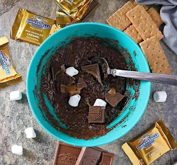 photo of making 1 minute chocolate caramel s'mores mug cake