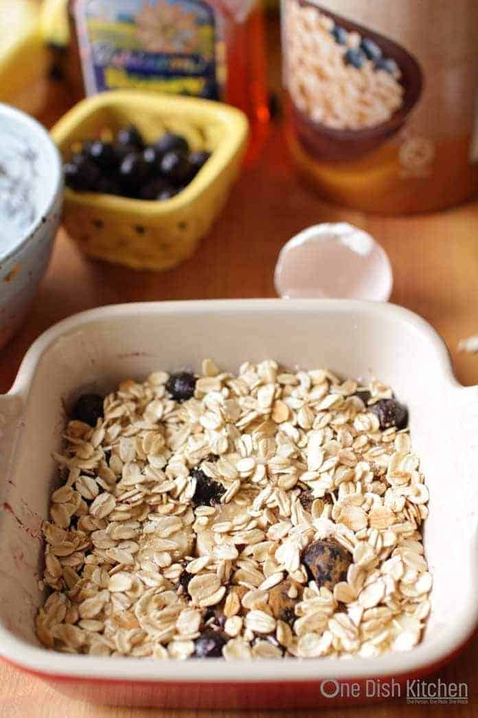 cooked oatmeal in baking dish with berries
