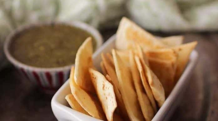 You just need 3 ingredients to make these homemade baked tortilla chips! They're crisp and delicious and can be ready in minutes. Perfect to enjoy with a dip, with cheese, or alone as a crunchy snack. You'll never go back to store brands when you can make tortilla chips this easily at home. | One Dish Kitchen