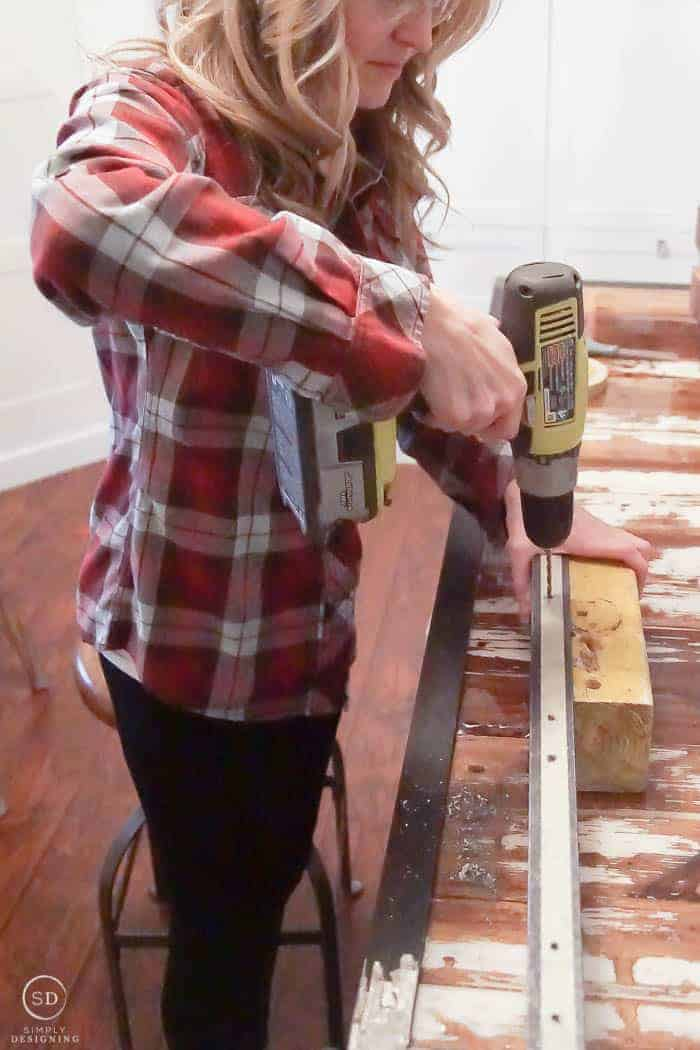 Drill pilot holes into angle iron for hanging spice racks