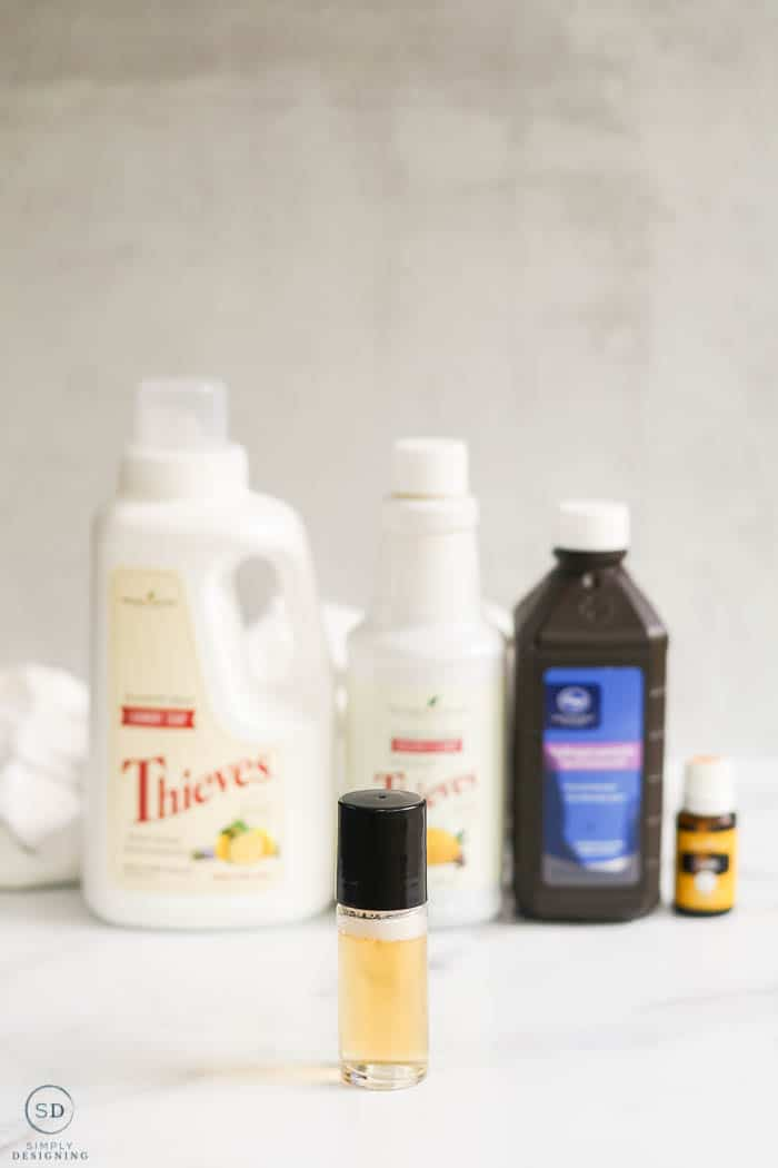 DIY Stain Remover in roller bottle with ingredients behind
