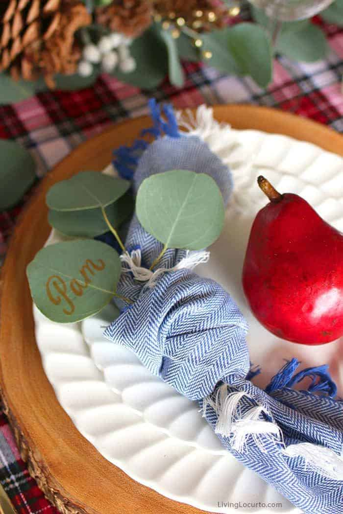 Plaid Christmas Table Decorations | Eucalyptus and fruit personalized table setting. LivingLocurto.com