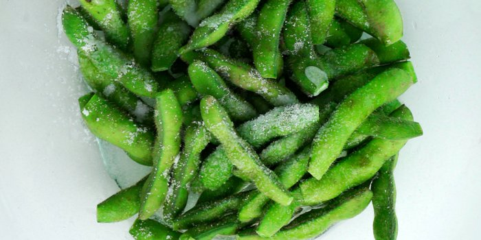 Scrubbing fresh edamame with salt removed the fine hairs.